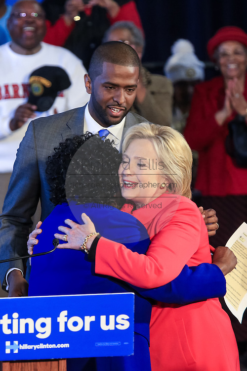 "Democratic presidential candidate Hillary Rodham Clinton embraces Bamberg County Schools Superintendent Thelma Sojourner during a ""Corridor of Opportunity"" Town Hall meeting at Denmark-Olar Elementary School February 12, 2016 in Denmark, South Carolina, USA. The event highlighted the disparities facing poor black families and rural poor in South Carolina."