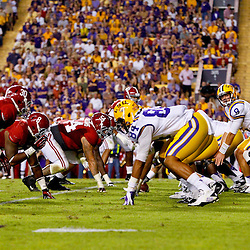November 3, 2012; Baton Rouge, LA, USA;  LSU Tigers quarterback Zach Mettenberger (8) lines up under center against the Alabama Crimson Tide during a game at Tiger Stadium. Alabama defeated LSU 21-17. Mandatory Credit: Derick E. Hingle-US PRESSWIRE