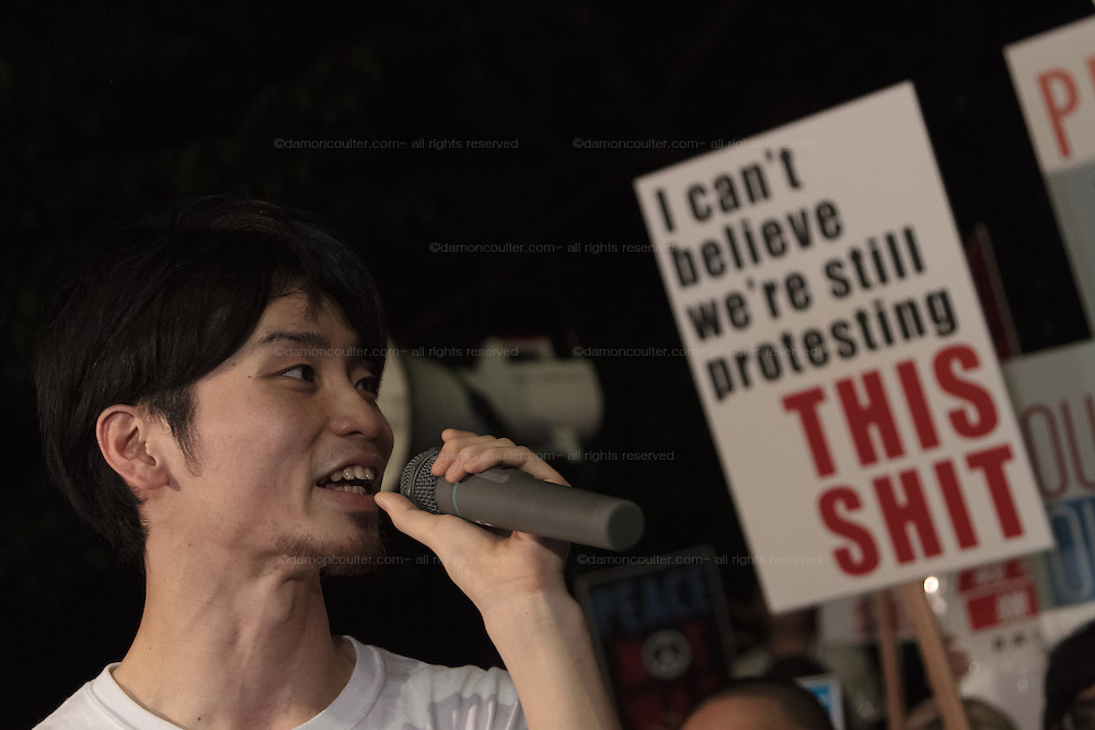 Young Japanese people and students take part in a protest rally by SEALD activists outside the Japanese Diet building, Nagatacho, Tokyo, Japan. Friday July 10th 2015 SEALD (Student Emergency Action for Liberal Democracy) is a student activist group that is against the neoliberal policies and nationalist agenda of Japanese Prime Minister, Shinzo Abe.