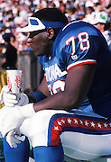 The National Football Conference Los Angeles Rams guard Jackie Slater (78) takes a drink on the sideline during the 1989 NFL Pro Bowl football game against the American Football Conference on Jan. 29, 1989 in Honolulu. The NFC won the game 34-3. (©Paul Anthony Spinelli)