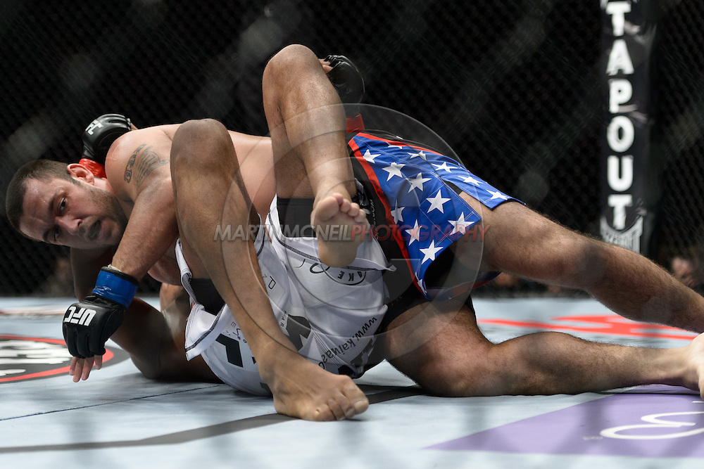 "STOCKHOLM, SWEDEN, APRIL 14: Cyrille Diabate (white shorts) and Tom DeBlass (blue/black shorts) during ""UFC on Fuel TV: Gustafsson vs. Silva"" inside the Ericsson Globe Arena in Stockholm, Sweden"