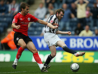 Photo: Rich Eaton.<br /> <br /> West Bromwich Albion v Barnsley. Coca Cola Championship. 01/09/2007. Barnsley's Stephen Foster (l) tackles as Craig Beattie shoots.