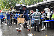 Spectators arrive with umbrellas as the rain falls ahead of the International Test Match 2019 match between England and Australia at Lord's Cricket Ground, St John's Wood, United Kingdom on 14 August 2019.