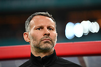 Head coach Ryan Giggs of Wales national football team watches his players competing against Chinese national men's football team in the semi-final match during the 2018 Gree China Cup International Football Championship in Nanning city, south China's Guangxi Zhuang Autonomous Region, 22 March 2018.
