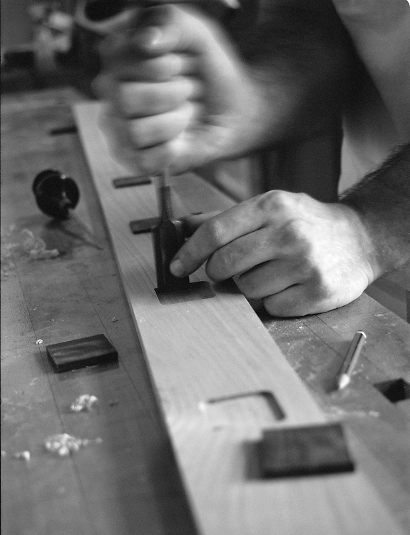 Anton Gerner fitting inlays to furniture