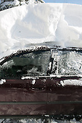 A car was buried in several feet of snow in Alden, New York, USA on Wednesday, November 19, 2014. Up to six feet of snow fell on the region Tuesday, stranding dozens of motorists on roadways and causing at least six deaths.