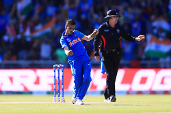 India's Yuzvendra Chahal celebrates taking the wicket of West Indies' Jason Holder, caught by Kedar Jadhav, during the ICC Cricket World Cup group stage match at Emirates Old Trafford, Manchester.