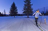 Brenda Winkler cross country skiing at dusk in Whitefish, Montana, USA model released