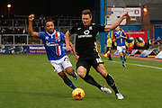 Carlisle United Forward Derek Asamoah on that attack against York City Defender Dave Winfield during the Sky Bet League 2 match between Carlisle United and York City at Brunton Park, Carlisle, England on 23 January 2016. Photo by Craig McAllister.