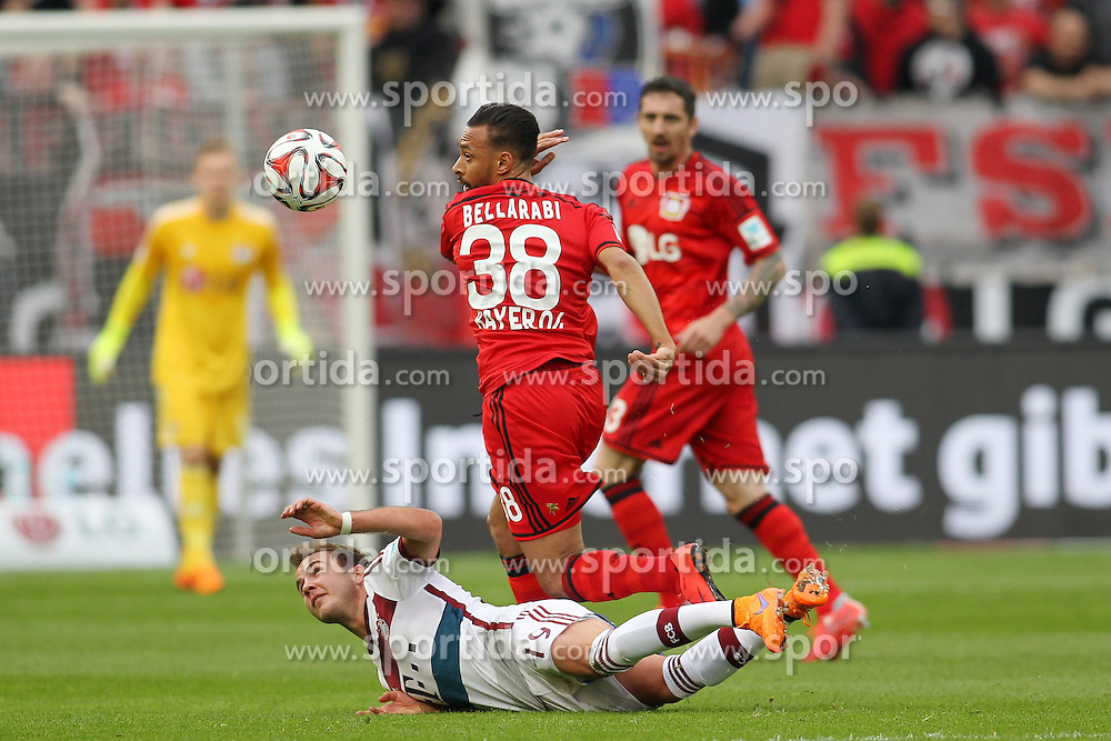 02.05.2015, BayArena, Leverkusen, GER, 1. FBL, Bayer 04 Leverkusen vs FC Bayern Muenchen, 31. Runde, im Bild Mario Goetze (FC Bayern Muenchen #19) im Zweikampf gegen Karim Bellarabi (Bayer 04 Leverkusen #38) // during the German Bundesliga 31th round match between Bayer 04 Leverkusen and FC Bayern Munich at the BayArena in Leverkusen, Germany on 2015/05/02. EXPA Pictures &copy; 2015, PhotoCredit: EXPA/ Eibner-Pressefoto/ Schueler<br /> <br /> *****ATTENTION - OUT of GER*****