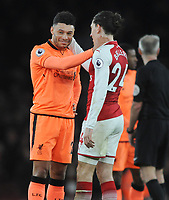 Football - 2017 / 2018 Premier League - Arsenal vs. Liverpool<br /> <br /> Alex Oxlade - Chamberlain of Liverpool at the final whistle with Hector Bellerin, at The Emirates.<br /> <br /> COLORSPORT/ANDREW COWIE