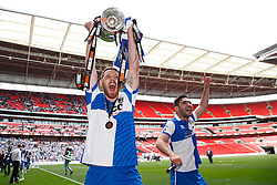 Tom Parkes of Bristol Rovers celebrates with the trophy after Bristol Rovers win the match on penalties  to secure promotion to the Football League 2 - Photo mandatory by-line: Rogan Thomson/JMP - 07966 386802 - 17/05/2015 - SPORT - FOOTBALL - London, England - Wembley Stadium - Bristol Rovers v Frimsby Town - Vanarama Conference Premier Play-off Final.