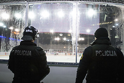 Policemen watching the game during ice hockey match between HDD Telemach Olimpija and HDD SIJ Acroni Jesenice at Winter Classic of HDD Telemach Olimpija called Pivovarna Union Ice Fest 2014, on December 18, 2014 on Republic Square, Ljubljana, Slovenia. (Photo By Matic Klansek Velej / Sportida.com)