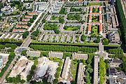 Nederland, Noord-Holland, Amsterdam, 14-06-2012; Slotervaart, sloop flats tussen Johan Huizingalaan (links) en aan weerszijden van de Emilie Knappertstraat in het kader van stadsvernieuwing. De laagbouw blokken in het midden, boven het water van de Slotervaart, vormen Blueband-dorp. .De wijk is een en van de Westelijke tuinsteden en gerealiseerd op basis van het Algemeen Uitbreidingsplan voor Amsterdam (AUP, 1935). Voorbeeld van het Nieuwe Bouwen, open bebouwing in stroken, langwerpige bouwblokken afgewisseld met groenstroken. ..Demolition of flats, due to urban renewal. This residential area is an example of garden cities of Amsterdam-west. Constructed on the basis of the General Extension Plan for Amsterdam (AUP, 1935). Example of the New Building (het Nieuwe Bouwen), detached in strips, oblong housing blocks alternated with green areas, built in fifties and sixties of the 20th century...luchtfoto (toeslag), aerial photo (additional fee required).foto/photo Siebe Swart