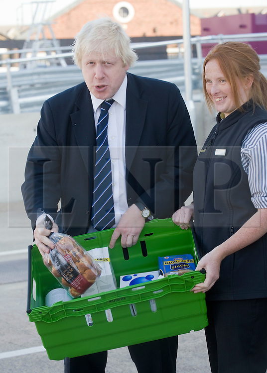 © Licensed to London News Pictures. 21/10/2011. London, UK. Mayor of London Boris Johnson on a tour of Waitrose's state of the art online distribution centre in Acton, West London today (21/10/2011). The centre delivers online order across the whole of London. Photo credit: Ben Cawthra/LNP