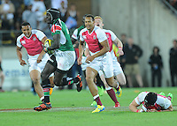 Kenya's Collins Injera is chased by England's Dan Norton in the final at the IRB International Rugby Sevens, Westpac, Wellington, New Zealand, Saturday, February 02, 2013. Credit:SNPA / Ross Setford