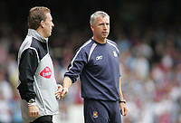 Photo: Paul Thomas.<br /> West Ham United v Arsenal. The Barclays Premiership. 24/09/2005.<br /> <br /> Paul Taylor the fourth offical tells West Ham manager Alan Pardew to settle down.
