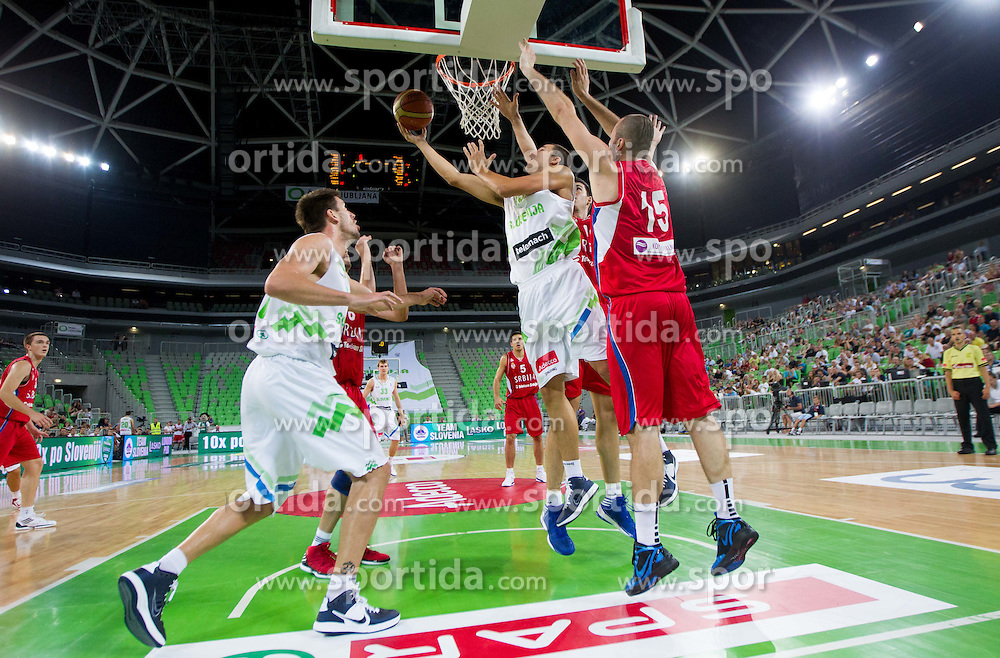 Jure Balazic of Slovenia vs Milan Macvan of Serbia during basketball match between National teams of Slovenia and Serbia in day 3 of Adecco cup, on August 5, 2012 in Arena Stozice, Ljubljana, Slovenia. (Photo by Vid Ponikvar / Sportida.com)