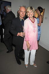 Actor NICKOLAS GRACE and MRS EDWARD HALL, she was Baroness Issy Van Randwyck at the annual Sotheby's Summer Party held at their auction rooms 34-35 New Bond Street, London W1 on 19th June 2008.<br />