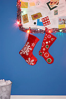 Christmas stocking decorations hanging on wall