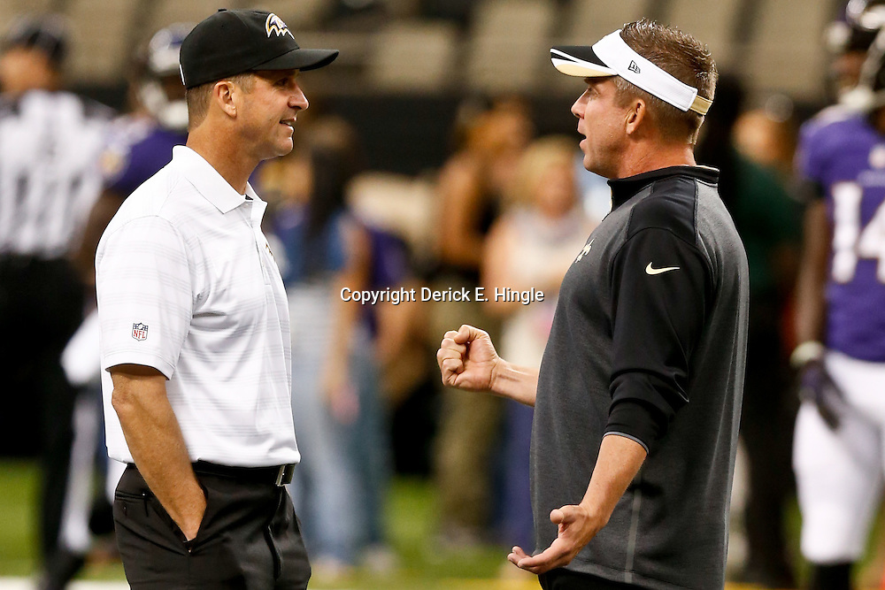 Aug 28, 2014; New Orleans, LA, USA; New Orleans Saints head coach Sean Payton and Baltimore Ravens head coach John Harbaugh before a preseason game against the Baltimore Ravens at Mercedes-Benz Superdome. Mandatory Credit: Derick E. Hingle-USA TODAY Sports
