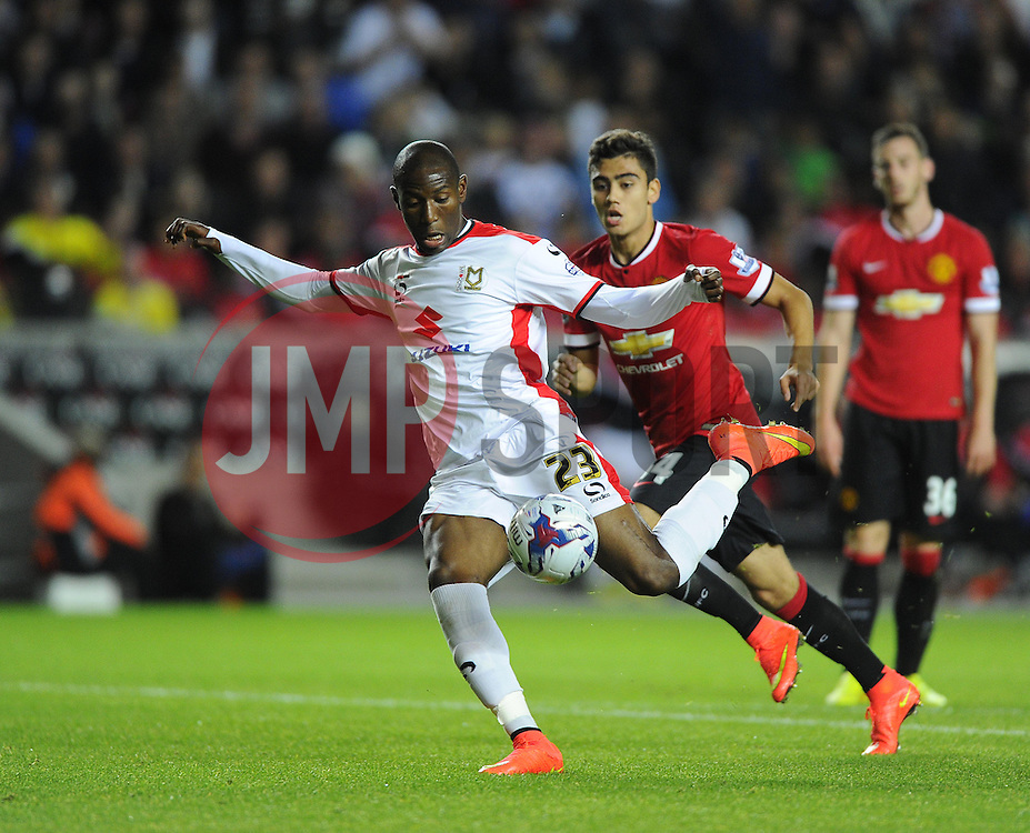 Milton Keynes Dons' Benik Afobe beats the Manchester United Defence to score his second and MK Dons fourth goal of the game - Photo mandatory by-line: Joe Meredith/JMP - Mobile: 07966 386802 26/08/2014 - SPORT - FOOTBALL - Milton Keynes - Stadium MK - Milton Keynes Dons v Manchester United - Capital One Cup