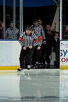 KELOWNA, BC - OCTOBER 2: Referee Jeff Ingram leads game officials onto the ice at the against the Kelowna Rockets against the Tri-City Americans  at Prospera Place on October 2, 2019 in Kelowna, Canada. (Photo by Marissa Baecker/Shoot the Breeze)