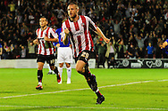 London - Tuesday, 21st September, 2010: Gary Alexander of Brentford   celebrates his equalising goal during the Carling Cup 3rd Round match at Griffin Park, London...Pic by: Alex Broadway/Focus Images