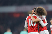 Arsenal midfielder Matteo Guendouzi (29) celebrates with Arsenal midfielder Mesut Ozil (10) after Arsenal midfielder Henrikh Mkhitaryan (7) scores a goal (2-0) during the Premier League match between Arsenal and Bournemouth at the Emirates Stadium, London, England on 27 February 2019.