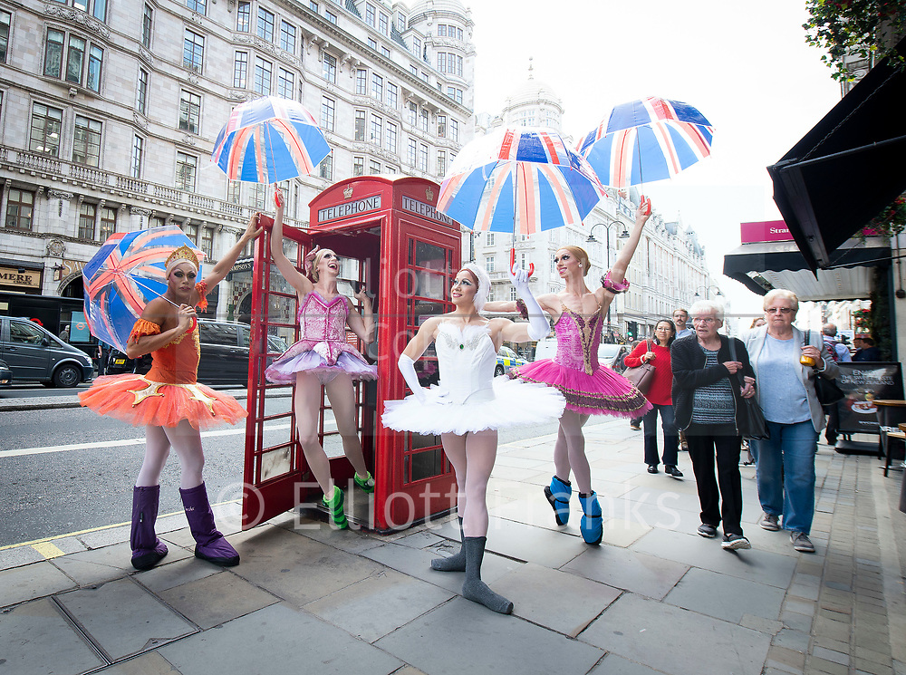 Hailing from New York City, the all-male comedy ballet company Les Ballets Trockadero de Monte Carlo, affectionately know as The Trocks, have arrived in London for the start of their Dance Consortium presented UK and Ireland 2018 Tour opening at The Peacock theatre<br /> Press photocall 10th September 2018 <br /> <br /> 'Warming up! The all-male comedy ballet company Les Ballets Trockadero de Monte Carlo, or The Trocks to their friends, explore the streets of London ahead of their Dance Consortium presented UK and Ireland Tour 2018 kicking off at The Peacock theatre'  <br /> <br /> <br /> Dancers as ballerinas: <br /> <br /> Robert Carter (OLGA SUPPHOZOVA)<br /> <br /> Carlos Hopuy (ALLA SNIZOVA)<br /> <br /> Joshua Thake (EUGENIA REPELSKII)<br /> <br /> Alberto Pretto (NINA IMMOBILASHVILI)<br /> <br /> Photograph by Elliott Franks