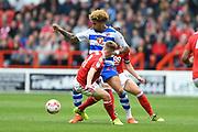 Reading midfielder Daniel Williams (23) battles with Nottingham Forest midfielder Ben Osborn (11) during the EFL Sky Bet Championship match between Nottingham Forest and Reading at the City Ground, Nottingham, England on 22 April 2017. Photo by Jon Hobley.