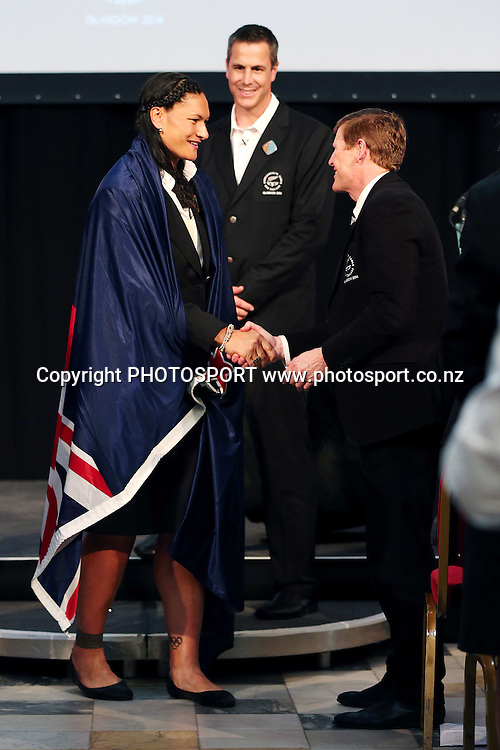 Valerie Adams is congratulated by President of the New Zealand Olympic Committee Mike Stanley after she is named as the New Zealand Flag Bearer for the 2014 Glasgow Commonwealth Games. The Kelvingrove Art Gallery and Museum, Glasgow, Scotland. Tuesday 22nd July 2014. Photo: Anthony Au-Yeung / photosport.co.nz