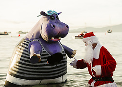 January 1, 2018 - Vancouver, British Columbia, Canada - Participants dress as santa claus (R) and hippopotamus (L) attend the 98th Vancouver Polar Bear Swim on New Years Day at English Bay in Vancouver, British Columbia, Canada. (Credit Image: © Andrew Chin/ZUMA Wire/ZUMAPRESS.com)
