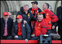 Sir Alex Ferguson takes a picture on his Mobile phone of the  fans  in Albert Square, Manchester,  As Manchester United celebrate winning their 20th league title winning the Premier League, Monday May 13, 2013. Photo by: Andrew Parsons / i-Images