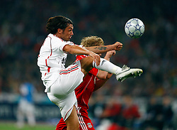 Athens, Greece - Wednesday, May 23, 2007: AC Milan's Paolo Maldini in action with Liverpool's Dirk Kuyt during the UEFA Champions League Final at the OACA Spyro Louis Olympic Stadium. (Pic by David Rawcliffe/Propaganda)