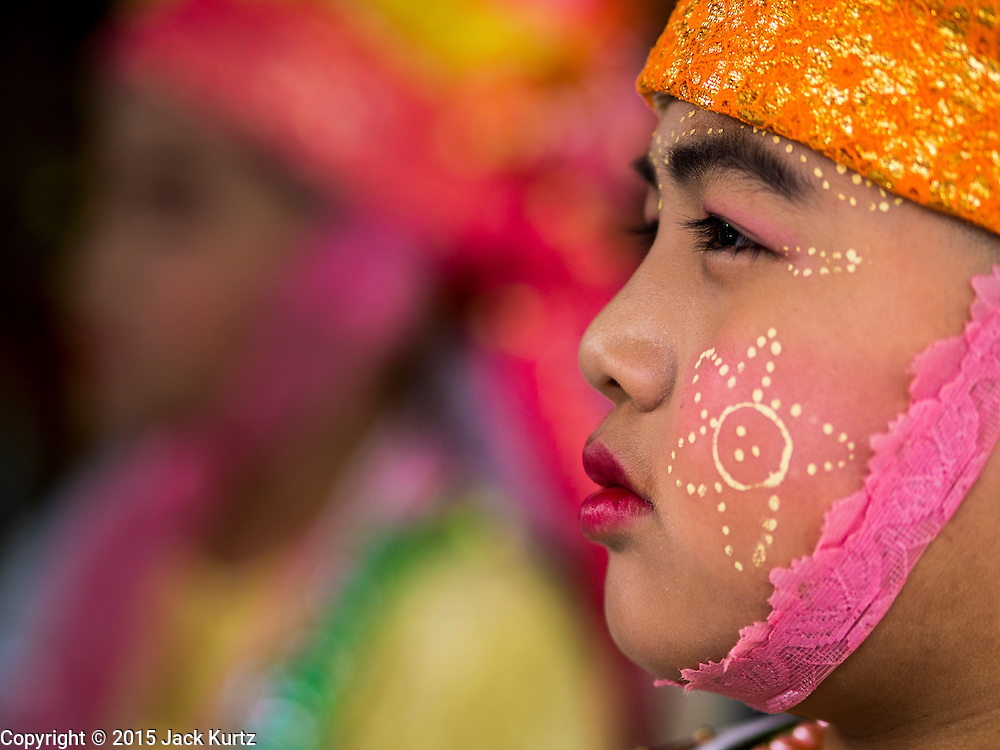 """04 APRIL 2015 - CHIANG MAI, CHIANG MAI, THAILAND: Boys being ordained at the Poi Sang Long Festival wait for the ordination ceremony to start. The Poi Sang Long Festival (also called Poy Sang Long) is an ordination ceremony for Tai (also and commonly called Shan, though they prefer Tai) boys in the Shan State of Myanmar (Burma) and in Shan communities in western Thailand. Most Tai boys go into the monastery as novice monks at some point between the ages of seven and fourteen. This year seven boys were ordained at the Poi Sang Long ceremony at Wat Pa Pao in Chiang Mai. Poy Song Long is Tai (Shan) for """"Festival of the Jewel (or Crystal) Sons.      PHOTO BY JACK KURTZ"""