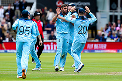 Liam Plunkett of England celebrates with teammates after taking the wicket of James Neesham of New Zealand - Mandatory by-line: Robbie Stephenson/JMP - 14/07/2019 - CRICKET - Lords - London, England - England v New Zealand - ICC Cricket World Cup 2019 - Final