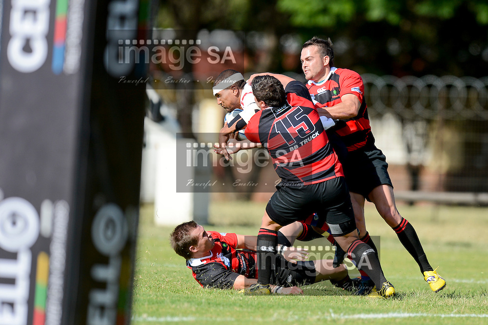 RUSTENBURG, SOUTH AFRICA - FEBRUARY 16 2013,  during match 6 of the Cell C Community Cup rugby match between BB Truck Noordelikes and Raiders held at the Noordelikes Rugby Club, Polokwane. Harold Primo (c) tackled by Zander Byleveld..Photo by ImageSA