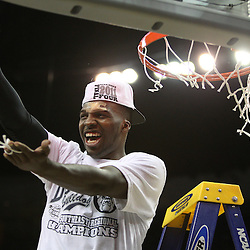 Mar 26, 2011; New Orleans, LA; Butler Bulldogs guard Shelvin Mack does a gator chomp after cutting down the net following a win over the Florida Gators in the semifinals of the southeast regional of the 2011 NCAA men's basketball tournament at New Orleans Arena. Butler defeated Florida 74-71.  Mandatory Credit: Derick E. Hingle