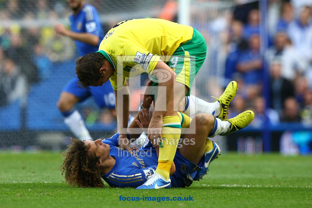 Picture by Paul Chesterton/Focus Images Ltd +44 7904 640267.06/10/2012.Grant Holt of Norwich and David Luiz of Chelsea clash during the Barclays Premier League match at Stamford Bridge, London.