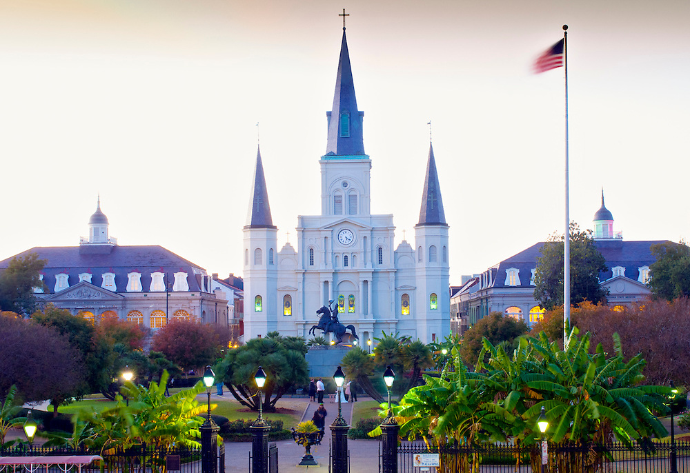 St. Louis Cathedral dominates the architecture of Jackson Square in the French Quarter of New Orleans. The public park was named after President Andrew Jackson whose equestrian statue is seen in front of the church.