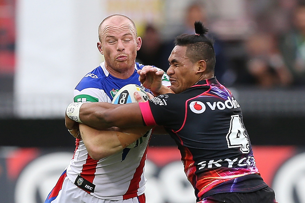 Beau Scott of the Newcastle Knights and Solomone Kata of the New Zealand Warriors clash during their round 12 NRL match at Mount Smart Stadium, Auckland on  Sunday, May 31, 2015. Credit: SNPA / David Rowland