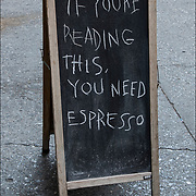Humorous blackboard sign outside reflecting the sense of humor and attitude of the coffe shop.<br /> <br /> &quot;If You're Reading This, You Need Espresso&quot;