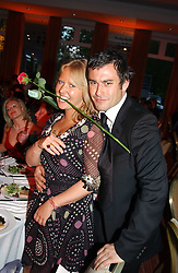 MISS ALICE BAMFORD and ZACH PULMAN at the Game Conservancy Jubilee Ball in aid of the Game Conservancy Trust held at The Hurlingham Club, London SW6 on 26th May 2005<br />