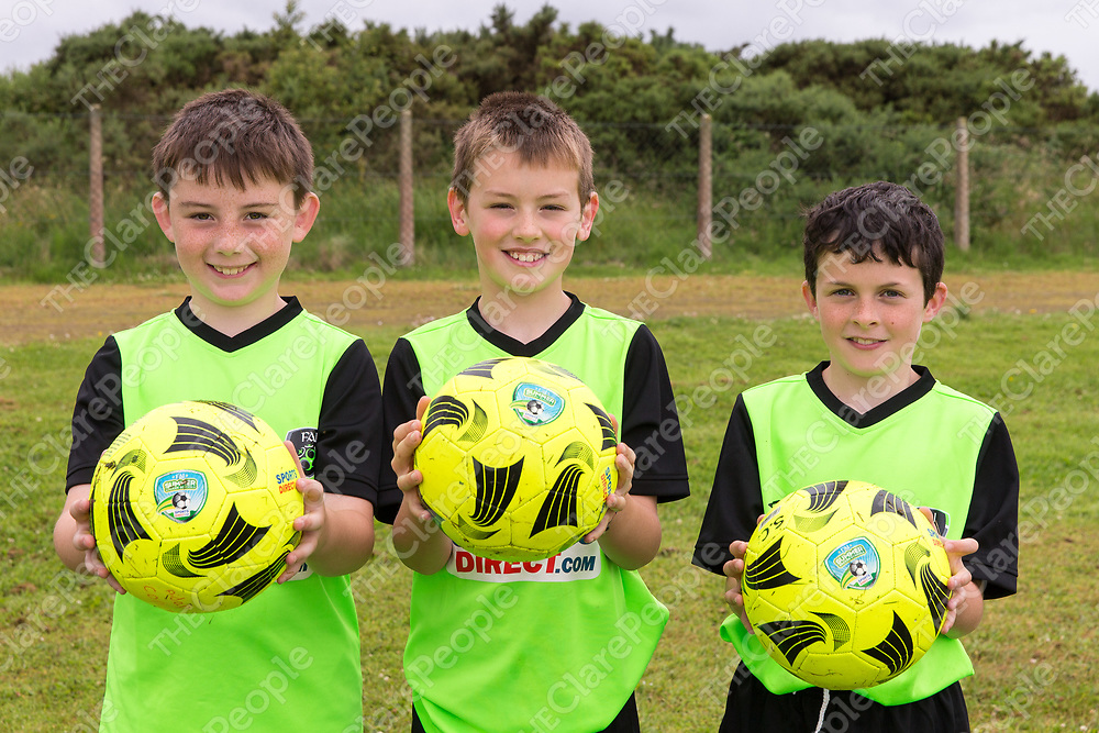 Aidan Conlon from Kilmaley, Bobby McArdle from Lahinch and Sean Carmody from Connolly attending the FAI Soccer Summer camp in Kilmaley