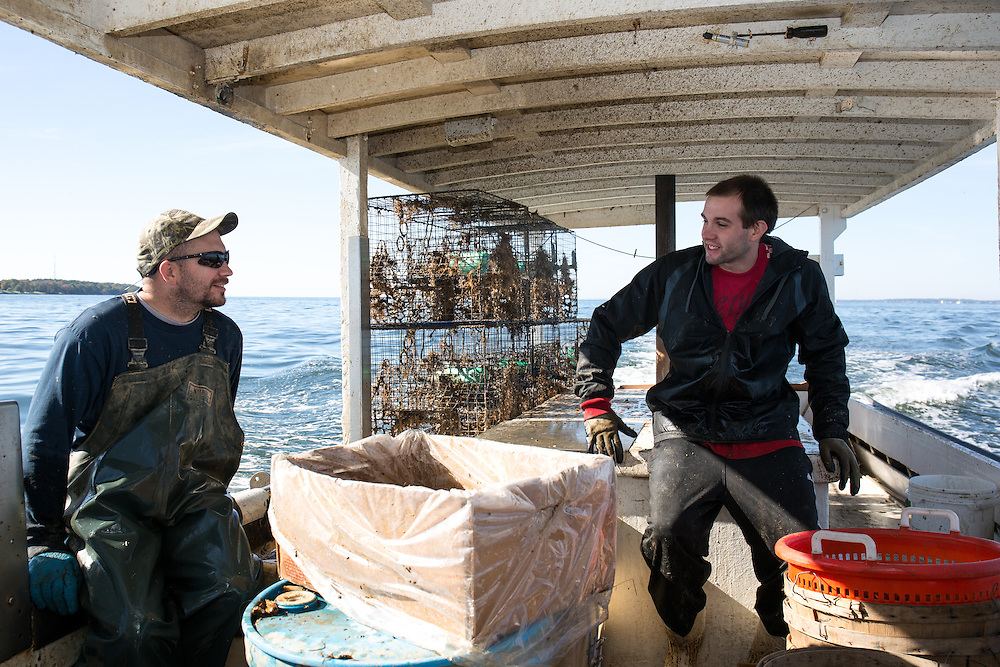 Ryan Ribb and Chris Shipley patiently waits to drop the crab traps into a new location in the Chesapeake Bay | October 11, 2015| October 11, 2015