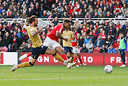 Middlesbrough forward Britt Assombalonga (9) forces a save from Nottingham Forest goalkeeper Costel Pantilimon (1)  during the EFL Sky Bet Championship match between Middlesbrough and Nottingham Forest at the Riverside Stadium, Middlesbrough, England on 6 October 2018.