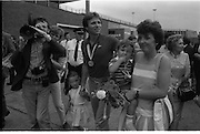 1983-15-08.15th August 1983.15-08-1983.08-15-83..Photographed at Dublin Airport..Pressed:..Gold medalist Eamonn Coughlan geeeted by press and supporters on the tarmac of Dublin Airport on his return from the World Athletic Championships in Finland. His wife Yvonne and chldren Suzanne (four) and Eamonn Jn (two) are with him. Suzanne walks hand in hand with her dad while his wife holds Eamonn Jn. His mother Kathleen walks behind.