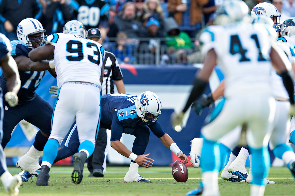 NASHVILLE, TN - NOVEMBER 15:  Marcus Mariota #8 of the Tennessee Titans recovers his fumbled snap during a game against the Carolina Panthers at Nissan Stadium on November 15, 2015 in Nashville, Tennessee.  (Photo by Wesley Hitt/Getty Images) *** Local Caption *** Marcus Mariota
