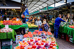 Buying vegetables from a stall in the Bullring Market in Birmingham, England, UK<br /> <br /> (c) Andrew Wilson | Edinburgh Elite media